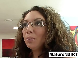 Brunette MILF in glasses tempts her nephew on the sofa