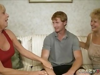 FFM threesome scene with two blonde GILFs