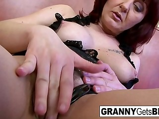 Mature redhead takes a big black cock deep in her ass