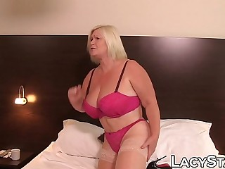 Promiscuous English GILF dominates a youthfull babe and loves it